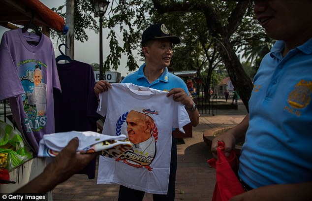 00578-2906730-Vendor_sale_the_Pope_Francis_t_shirts_at_Rizal_Park_in_Manila_ci-a-9_1421224809256.jpg