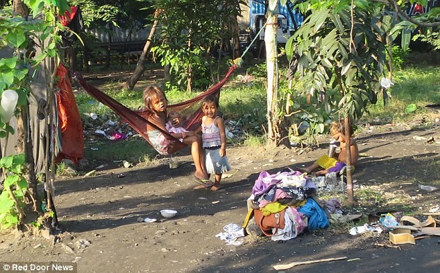 0578-2906730-PIX_for_Mail_Online_Exclusive_Street_Children_in_Manila_jailed_a-a-12_1421135531472.jpg