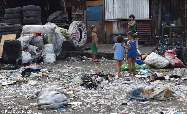0578-2906730-PIX_for_Mail_Online_Exclusive_Street_Children_in_Manila_jailed_a-a-16_1421135531569.jpg