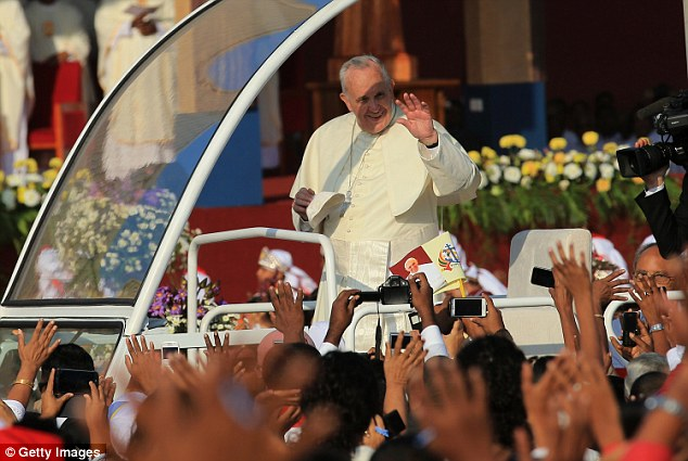0578-2906730-Pope_Francis_who_arrived_in_Manila_tomorrow_waves_to_the_faithfu-a-44_1421239646221.jpg