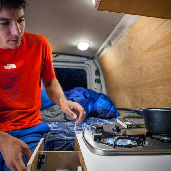 alex-honnold-cooking-kitchen_ph-jpg.20691_Alex Honnold's Ultimate Adventure Vehicle_Van Dwelling / Rubber Tramping_Squat the Planet_9:30 AM