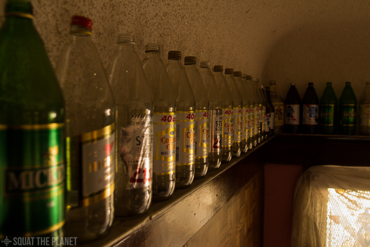 beer-bottles-along-the-wall_10-08-2013_004-jpg.40230_The Church Of Carl Sagan Squat_Squatting_Squat the Planet_1:02 PM