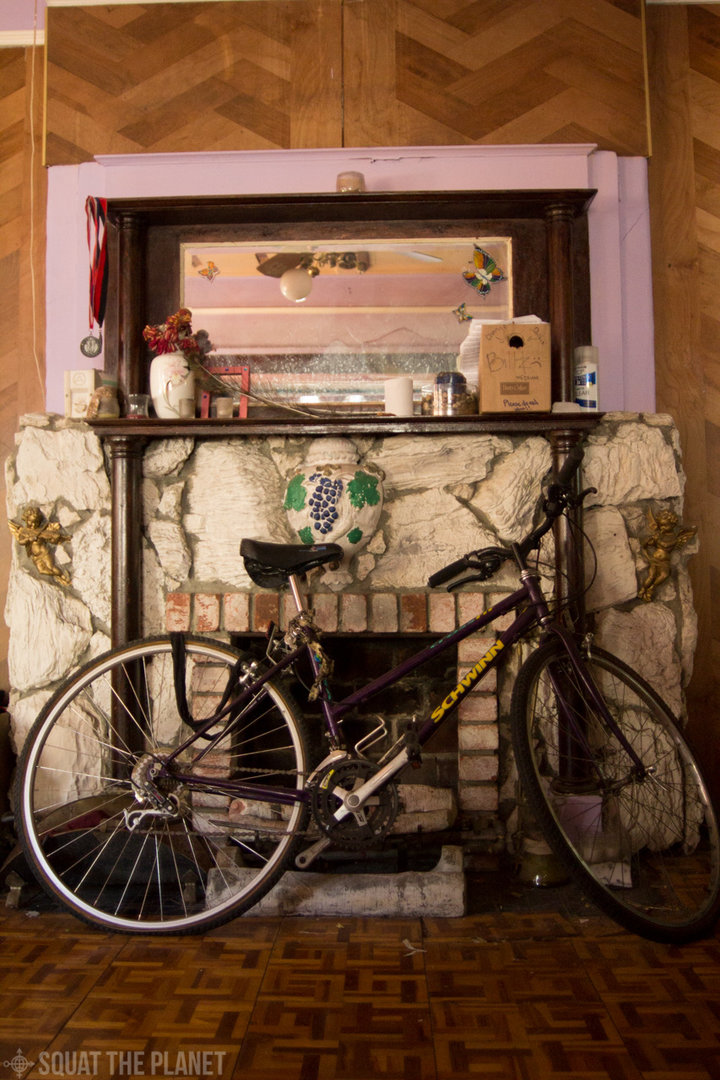 bike-in-front-of-fireplace_10-08-2013_030-jpg.40232_The Church Of Carl Sagan Squat_Squatting_Squat the Planet_1:02 PM