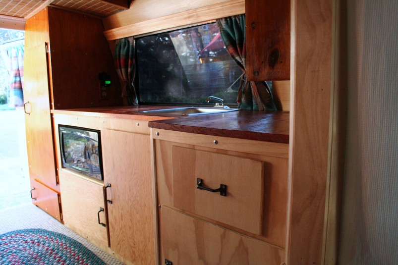 "finished_cabinetskitchen-803x535-jpg.20925_Living in a 1991 Chevrolet G20 ""Sport Van""_Van Dwelling / Rubber Tramping_Squat the Planet_{posttime}"