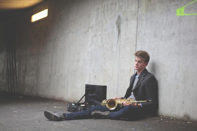 man-sitting-down-with-saxophone-780x520.jpg