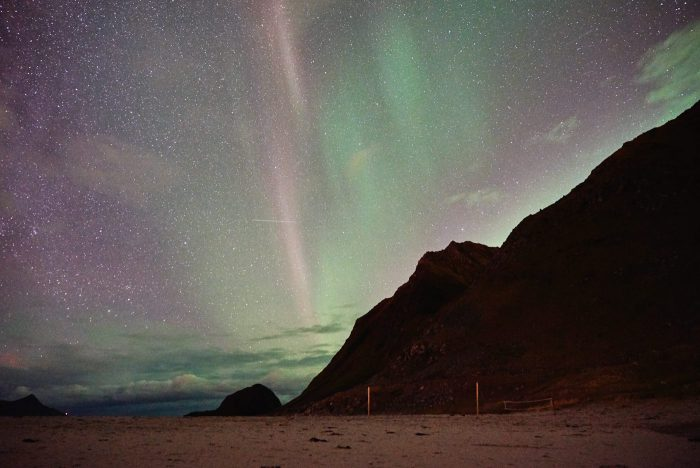 northern-lights-aurora-lofoten-by-campervan-haukland-beach-faint-700x468-jpg.47596_Lofoten by Campervan: Watching the Northern Lights on Haukland Beach_Van Dwelling / Rubber Tramping_Squat the Planet_3:02 PM