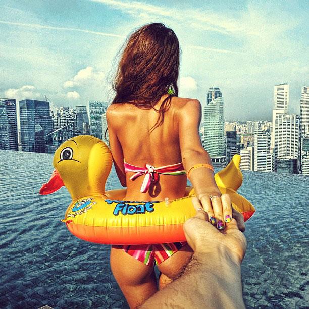 photographer-follows-girlfriend-around-the-world-holding-hand-photo-series-3.jpg
