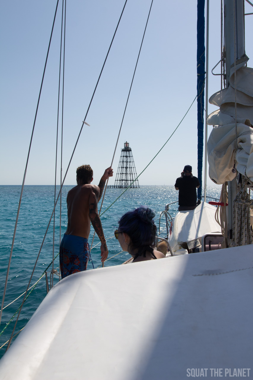 pointing-to-the-key_05-07-2013-jpg.11980_Sailing the Dry Tortugas and Decapitation_Boat Punk / Sailing_Squat the Planet_5:19 PM