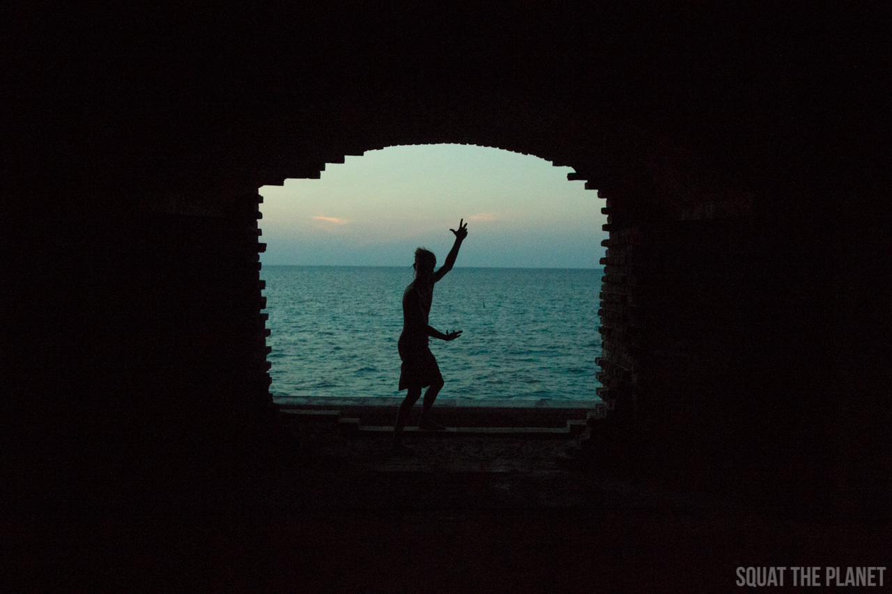 ryan-poses-in-archway_05-08-2013-jpg.11972_Sailing the Dry Tortugas and Decapitation_Boat Punk / Sailing_Squat the Planet_5:19 PM
